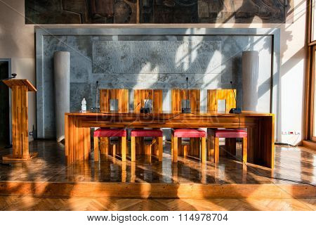 VENICE - AUGUST 27: Modern Wooden Table and Chairs Illuminated by Bright Sunlight in Aula Baratto Room at Ca Foscari University of Venice. August 27, 2015 in Venice
