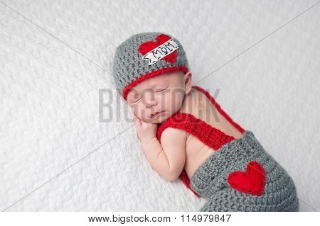 Newborn Baby Boy Wearing A