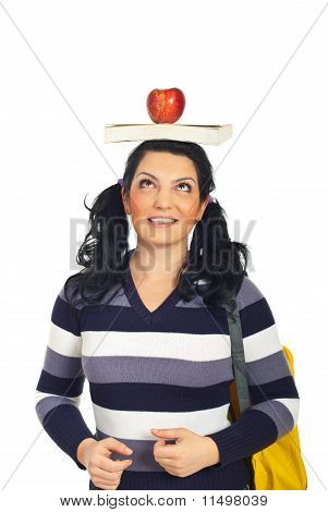 Cheerful Student Woman With Book On Head