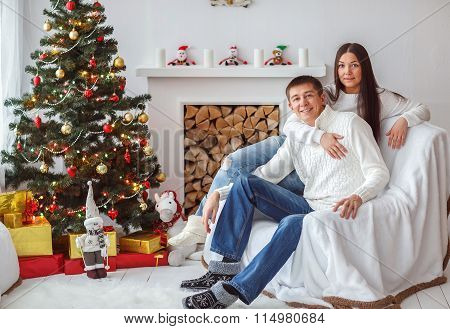 Young Couple At The Christmas Tree.