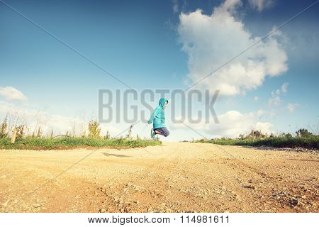 Profile view of a young boy playing skipping rope