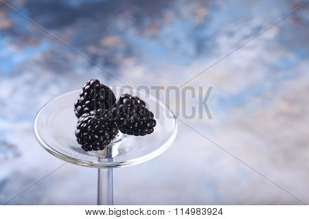 Blackberries On Blue Background