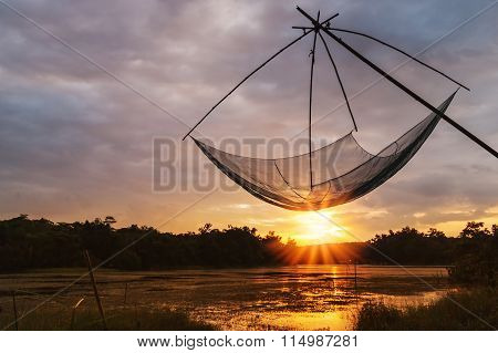 Asians Tool For Fishing With Color Of Sunset On Blurred Background