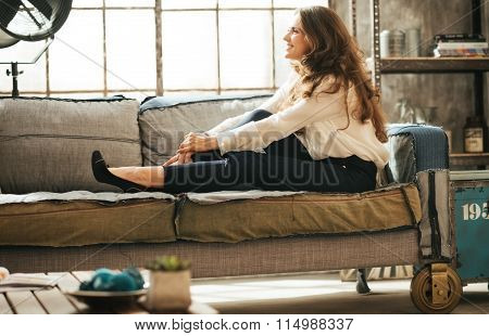 Smiling Relaxed Young Woman Is Relaxing On Couch