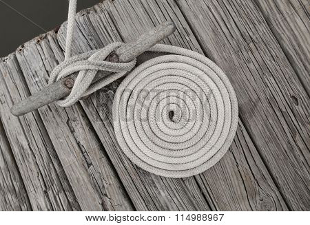 Coiled of rope on weathered dock