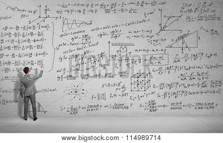 Man draw science formulas