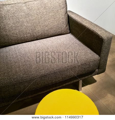 Gray Sofa And Bright Yellow Table
