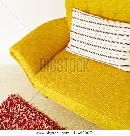 Yellow Sofa With Striped Cushion