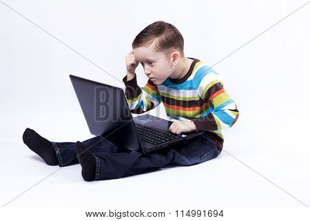 Boy With A Laptopboy Thinks Looking At Laptop