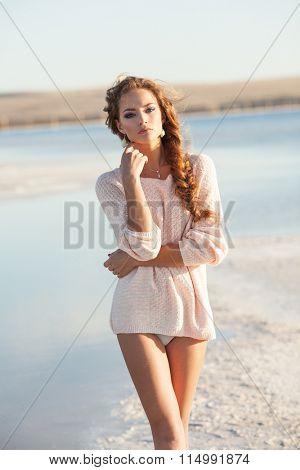 Beautiful young girl near a lake