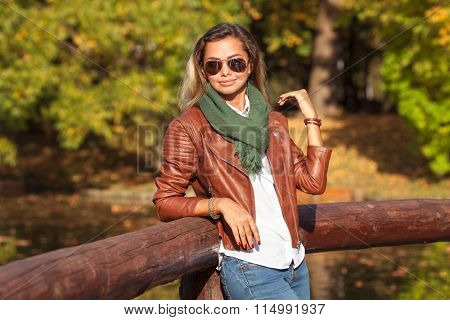 Beautiful young blond woman in a park