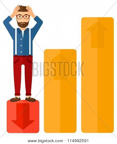 Businessman standing on low graph.