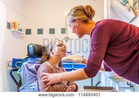 Disability a disabled child being cared for with help from a carer