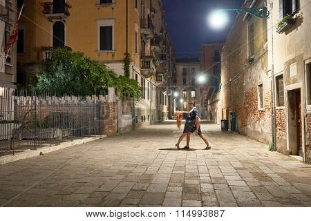 Pair dancing on streets of Venice