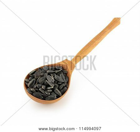 Sunflower seeds with wooden spoon