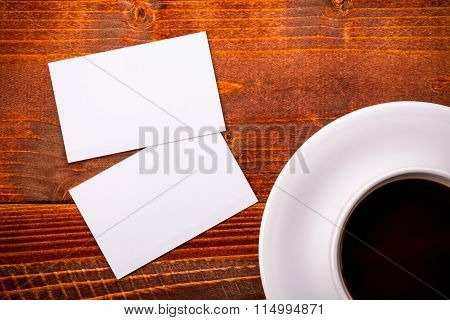 White Coffee Cup With Business Card On Table
