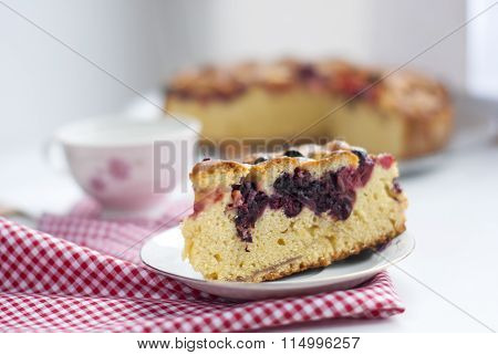 Photo of piece of cake with cherries