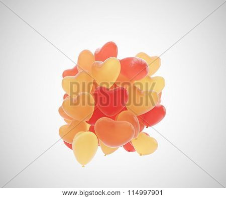 Heap of heart shaped balloons floating in the air.