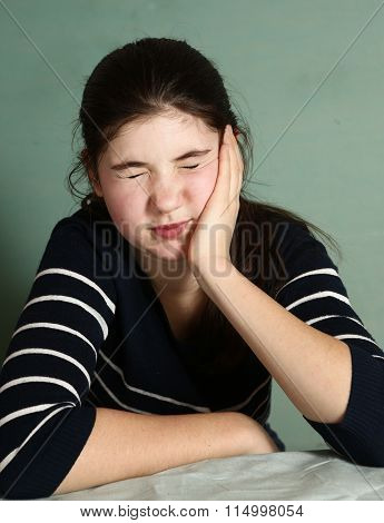 Girl With Dark Hair Have Severe Toothace