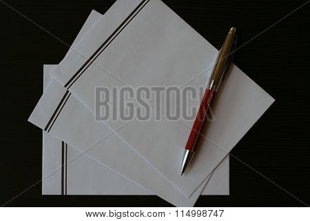 Blank White Envelopes For Funeral Card On Black Table
