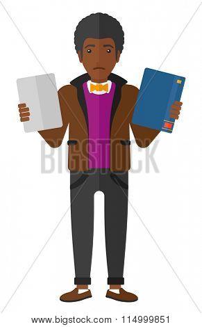 Man choosing between book and tablet.