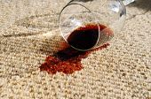 foto of glass-wool  - A glass of red wine spilt on a pure wool carpet - JPG