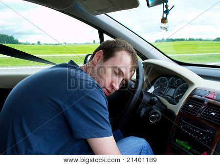 Young Man Sleeps In Car