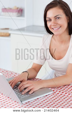 Portrait Of A Smiling Woman With A Laptop