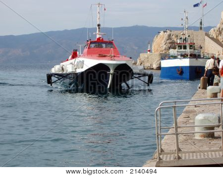 Hydrofoil Arives At The Port Of Hydra Island, Greece