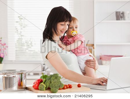 Good Looking Woman Holding Her Baby In Her Arms