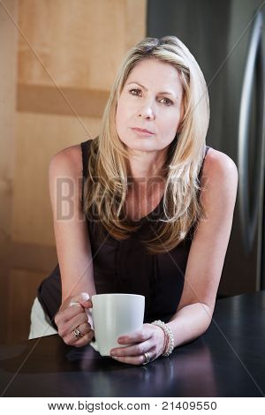 Blonde Woman Holding Coffee Mug