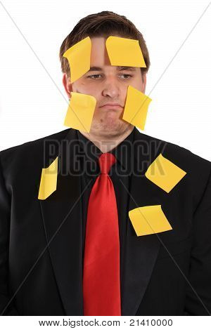 Businessman With Sticky Note Paper On His Face