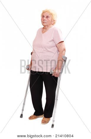 Happy elderly woman with her crutches.