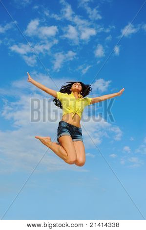 Beautiful Woman over blue Sky