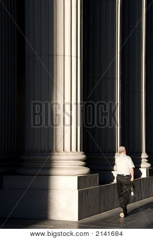 Man Passing By A Bank