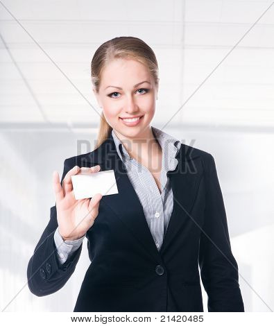 businesswoman in black suit holding empty blank