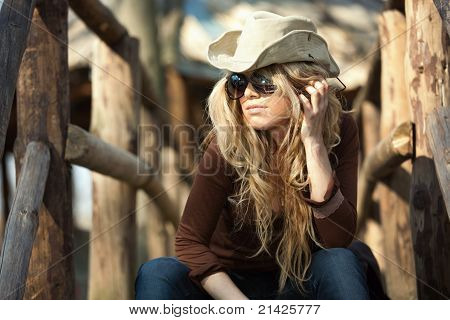 Outdoor Country Style Fashion Portrait of Attractive Blond Young Woman