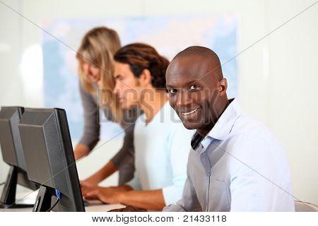 Office workers in front of desktop computer