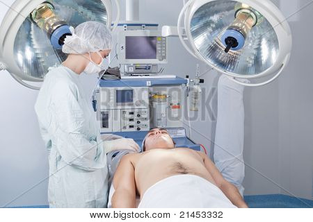 Surgeon checking the patient before operation in operating room