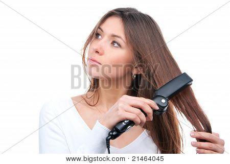 Brunette Woman Using Hair Straighteners Black Flat Iron To Make New Stylish Hairstyle