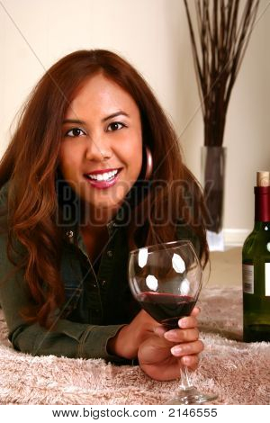 Beautiful Model Drinking Wine On Bed
