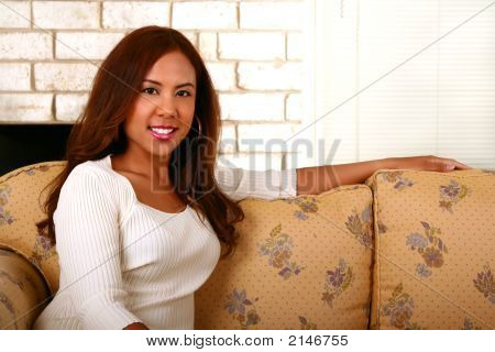 Beautiful Model Sit On Sofa