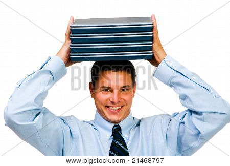 Smiling Businessman Holding Laptops