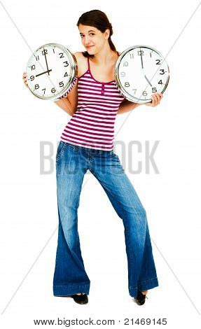 Close-up Of A Woman Holding Clocks