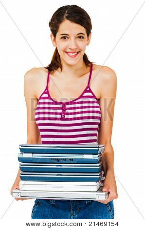 Confident Woman Holding Stack Of Laptops