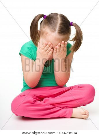 Little Girl Is Sitting On Floor And Crying