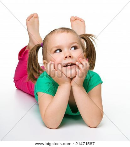 Portrait Of A Cute Little Girl Laying On Floor