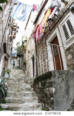 Old street in Dubrovnik with clotheslines of laundry drying (Croatia)