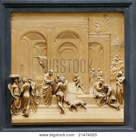 "Isaac with Esau and Jacob by Ghiberti. Detail of the panel on the doors (""Gates of Paradise"") of the Duomo Baptistry, Florence, Italy."