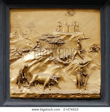 """Cain and Abel by Ghiberti. Detail of the panel on the doors (""""Gates of Paradise"""") of the Duomo Baptistry, Florence, Italy."""